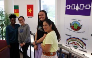 Four students with flag