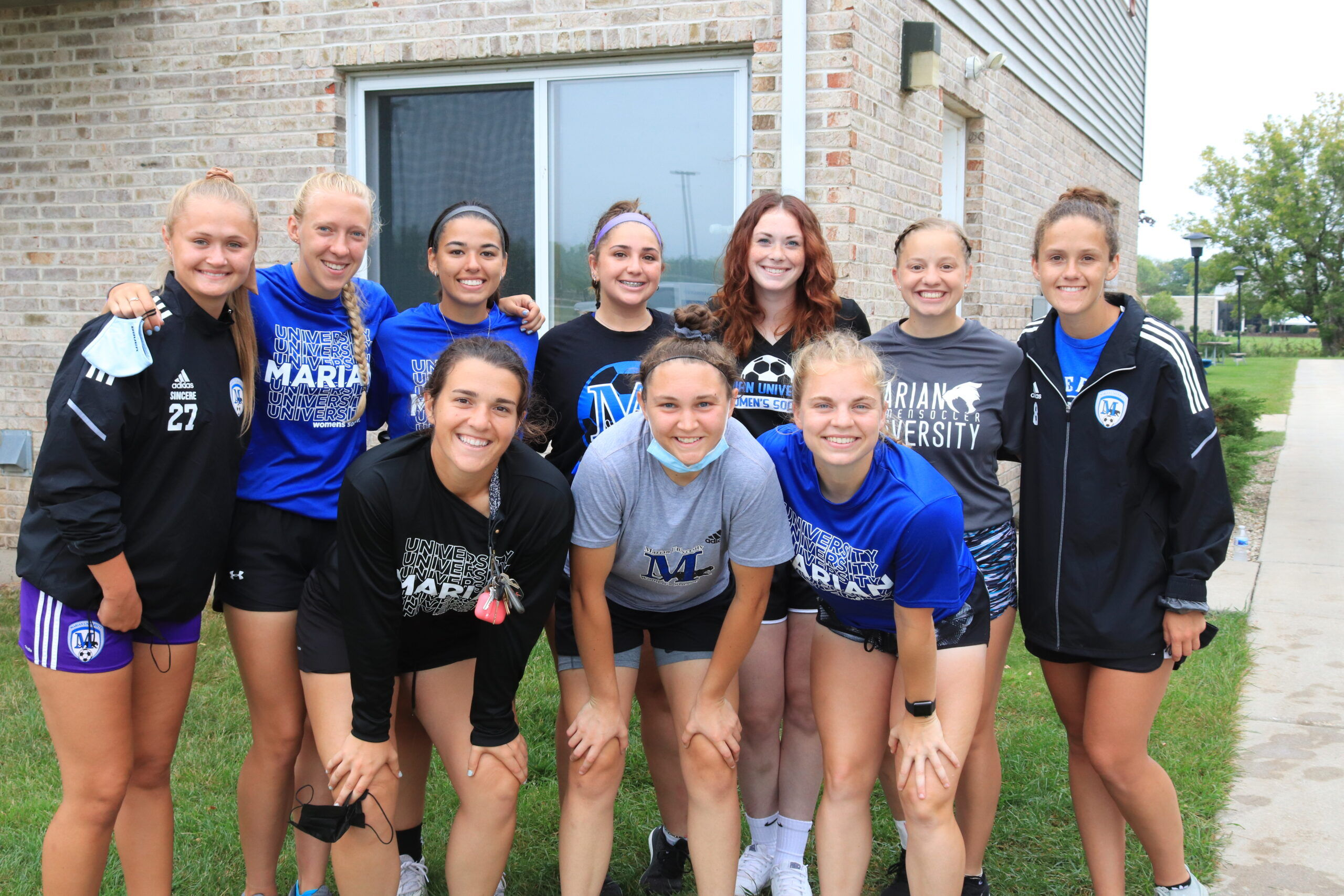 Marian University Women's Soccer team takes a break from helping new students move-in to their residence halls.